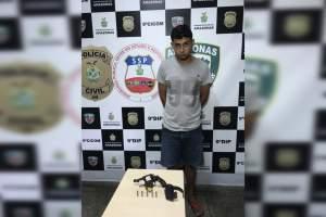 Polícia prende com arma e munições homem procurado por roubo no bairro Gilberto Mestrinho